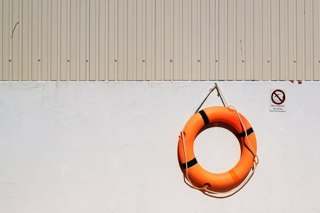 Image of an orange life raft hanging on a wall
